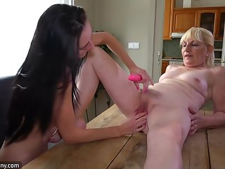 Cougar Broad And Pretty Woman Masturbating Encircling Dildo On The Writing-desk